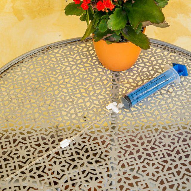 La siringa con le due prolunghe montate, in evidenza l'indispensabile rubinetto
